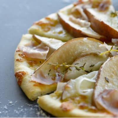 Savory pear and prosciutto pizza